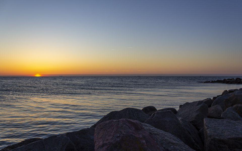 Hintergrundbild Buhne mit Sonnenuntergang
