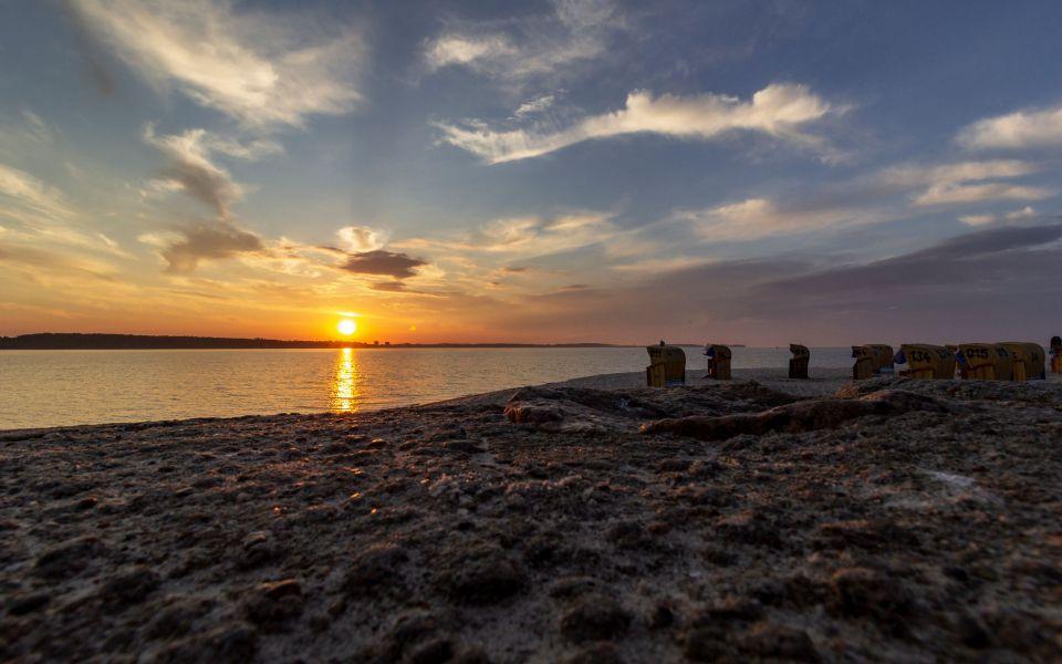 Hintergrundbild - Sonnenuntergang über der Förde